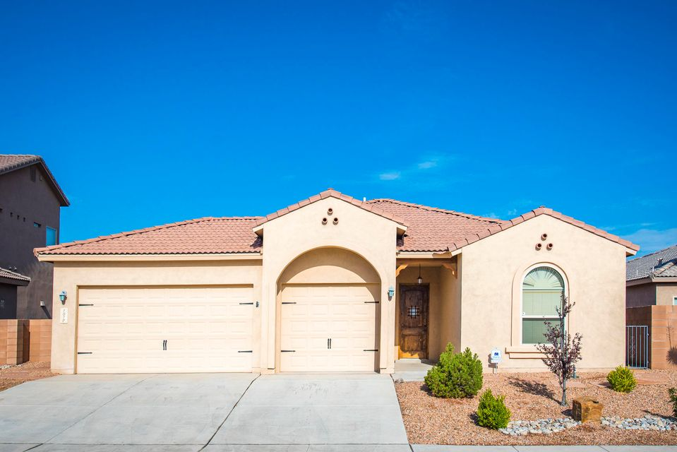 Gorgeous Energy Efficient Home in Gated Community now available!  This beautiful open-concept home is a must see!  Home Features Tankless Hot Water Heater, Refrigerated Air, Tile roof, 10ft ceilings, 8 ft High garage doors, oversized 3 Car Garage with Epoxy Flooring! Very nice lot with low maintenance landscaping. Upgraded Tile, Granite Counter Tops in Kitchen, Stainless Steel Appliances, Stainless Steel Apron Sink, Custom Cabinets, custom stacked stone fireplace, and Energy Efficiency! Home has a HERS rating of 61. Come see this home today, you will not be disappointed!