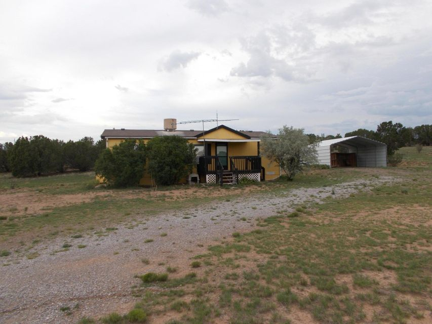 Nestled in the foothills of the Sandia Mountains, with trees providing an attractive background,near one of the best pre-K thru 16 scnools in New Mexico.Fully fenced,1,120 sf Yellow home with front and rear porches, large 20x20 carport, 3, br and 2 bath rooms. Possible to use the home for a professional practice as well. Near Walmart, Smiths, Walgreens Doctors Restaurants, etc. Take Old Route 66 to Lexco Road, south 2 miles to Martinez, 1 mile West to this lovely property on the West ( see my sugn).