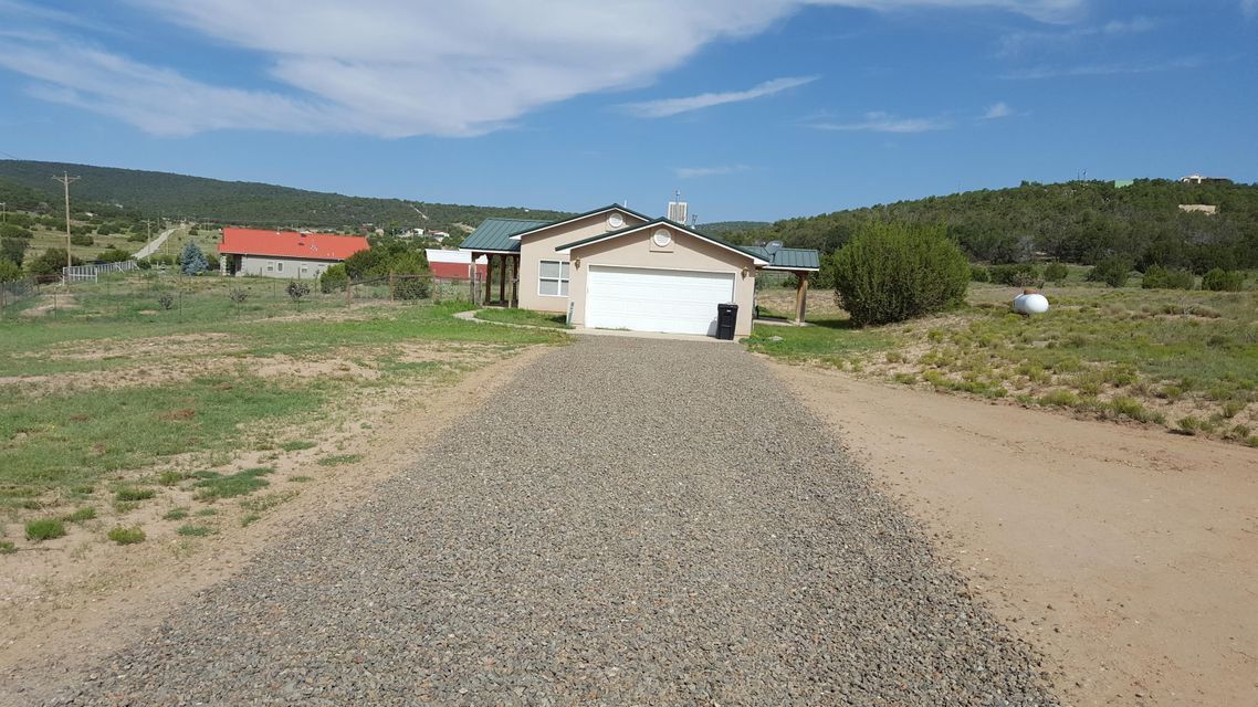 **Price reduced** Take another look!New driveway access, gravel. Tranquil Valley beauty! 5 acres plus makes this little ranchette very desirable. Three bedroom with 2 full baths, fenced yard for the pets, plenty of room for horses. Pellet stove for those cold winter nights!