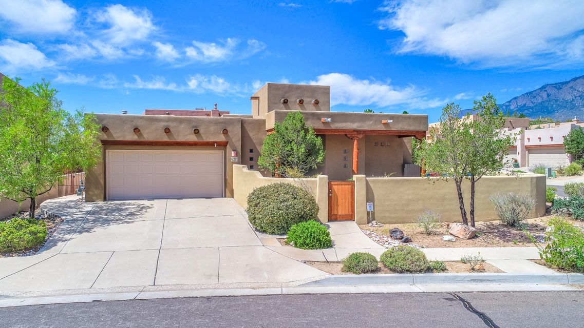 **Premium Property**Pueblo style single story home on a corner lot in High Desert with mountain views of the Sandia's. This is a must see!  Front Courtyard w/large covered portal to sit out for your morning coffee and look at the VIEWS of South Peak. This Southwest style home is both elegant & casual featuring raised T& G ceilings, vigas, corbels and beams. Tile floors in entry, kitchen, baths and utility.  Custom Kiva (like) gas log fireplace to keep warm on those cold winter nights and VIEWS GALORE of the Sandia's out of great room, formal living, kitchen and breakfast area.  This floorplan is open and spacious and has plenty of natural light. This is a split bedroom floorplan in case the mother in law needs her own space.