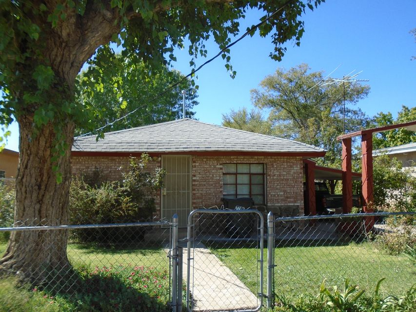 One owner home in the heart of Belen. Gorgeous green lot in a pleasant neighborhood. Cute 2 bedroom home. Appliances are negotiable.