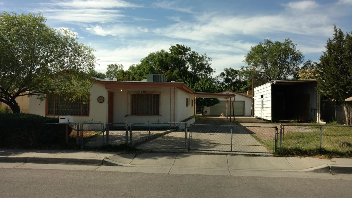 Great 3 bedroom home sits on larger lot next to the zoo!  Has second 1 bedroom detached casita. Includes two living areas, RV parking and large lot behind home.  Call today for your private showing.