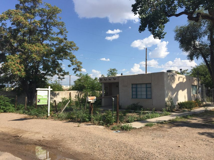 This casita nestled in the heart of the North Valley is a diamond in the rough. It can be fixed up and transformed into your dream house. The house is walking distance from shopping and has walking trail access along the acequias which are a staple of the area! The home is being sold AS IS. Property may have a special use permit and possible irrigation.