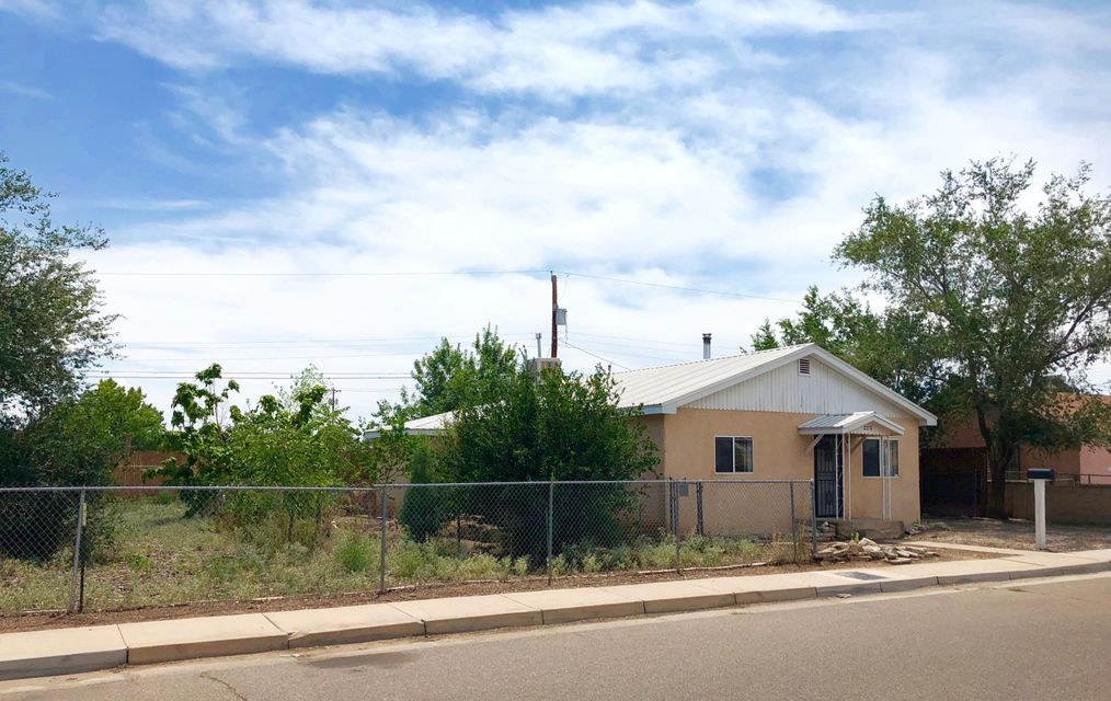Why Rent when you can Own...  Great Home on a ''Double-Sized Lot'' just off Rio Grande Blvd.... and on a cul-de-sac.  Close to Old Town, the Rio Grande, Nature Center, I-40... and so much more! House includes: 2 Master Bedrooms with large walk-in closets and siting rooms. NEW CARPET just installed! 1 Full Bath,  Great Room and updated kitchen, all under a metal roof. 1-Car Garage (or great workshop) + Carport. Remember the double-sized lot - fully fenced with fruit trees, raised-bed garden... plus room for a lot more. Back/Side-yard access possible. You could add a garage/workshop... or expand the house...and still have space.  Sold AS-IS!  Seller will not make any repairs.