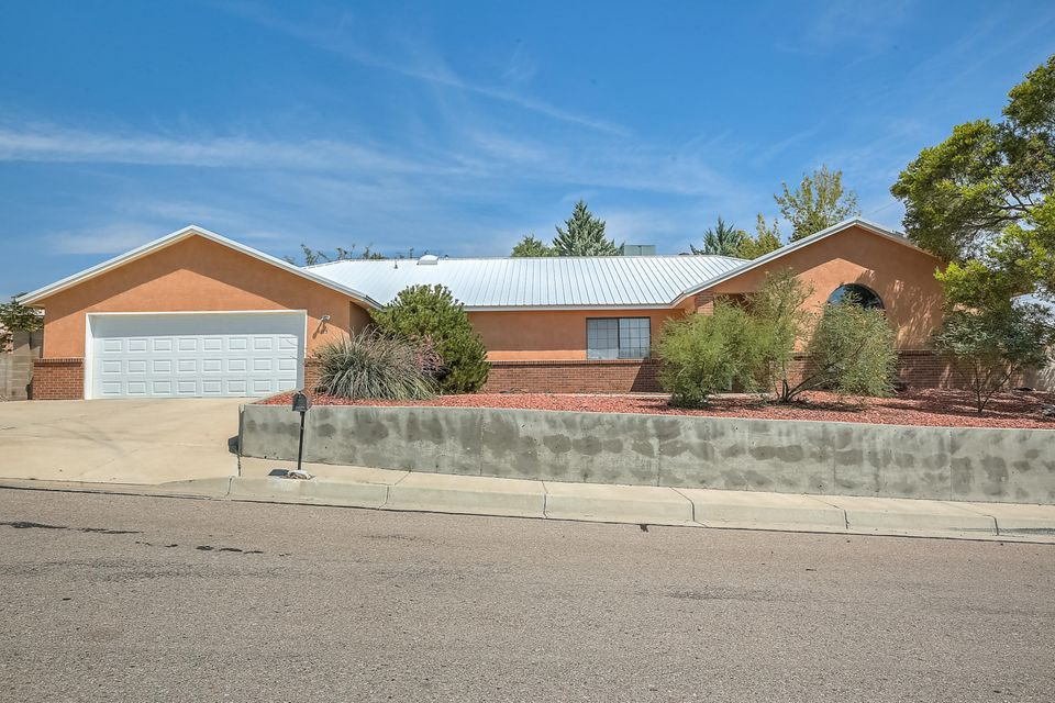 Rare treasure. The most cheerful one story/open floorplan home drenched in natural light w/soaring vaulted ceilings/skylights... + a DREAM garage, side yard RV parking, & one heck of a centralized location! You'll love spending your life years here. Special features include comfortable refrigerated air, durable pitched / metal roof, tasteful engineered wood flooring in main areas, beautiful decorative built-in shelves (buyer may easily convert TV space back to a fireplace), master bathroom with separate shower from jetted tub and dual sinks / vanity, and best of all some dynamite outdoor living spaces either under the covered outdoor patio or in the fully-developed-and-matured, stunning, yet low-maintenance backyard gardens. The garage is at least 4-car tandem, a MUST-see for hobbyists!