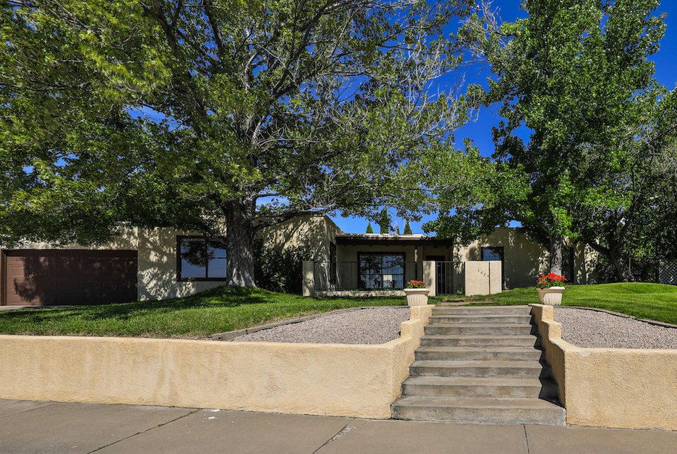 OPEN HOUSE SUNDAY 11/11.  Incredible opportunity to live in the highly sought after neighborhood of Academy Estates!  Big and bright, built for your  family with line of sight views from the kitchen to the formal living/dining room, family room and media room.   The media room is huge with enough for a pool table or to use as a kids play room.  Master has french doors that lead out to the sun room and also has an enormous walk in closet with 3 additional closets. On a huge lot,  the back yard has fruit trees, garden area and is perfect for NM outdoor living.  RV pad and 3 car parking, garage is oversized for all your toys with workshop area and tons of storage. New commercial grade TPO roof with transferrable warranty. Don't miss this extraordinary home! Call today to see!