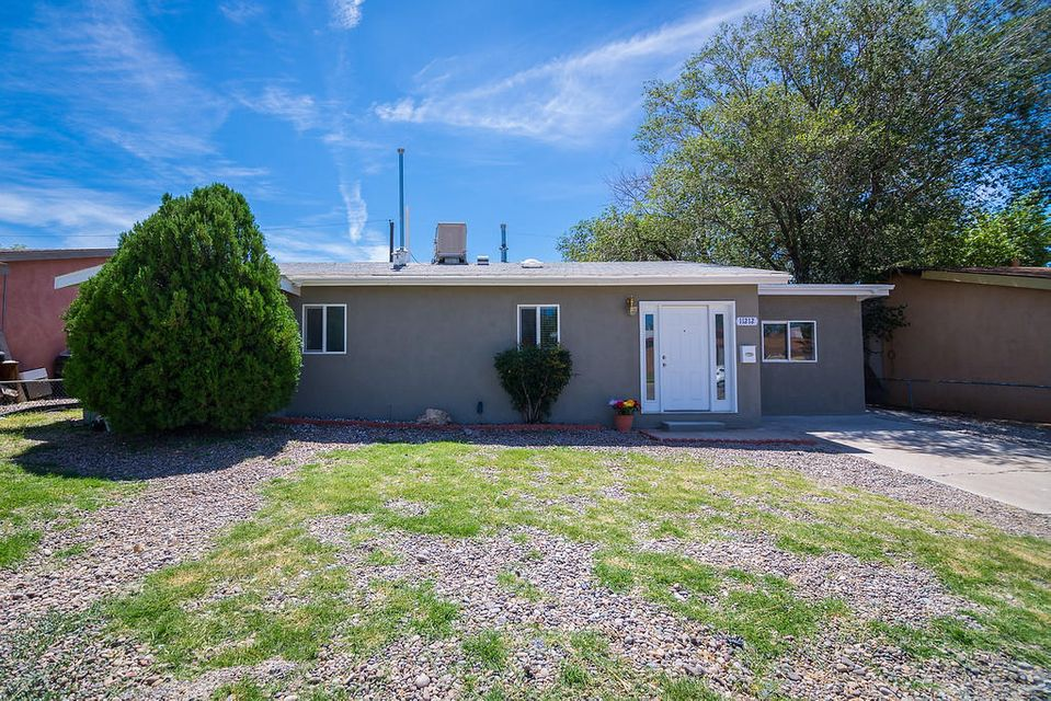 This cute home in the NE Heights is ready to move in. The seller is willing to leave the appliances with an acceptable offer. The home has many recent updated such as a remodeled kitchen, bathroom and living and dining area . The living area has a built in electronic fireplace with tile surround. The home has a 200 square foot sunroom too!