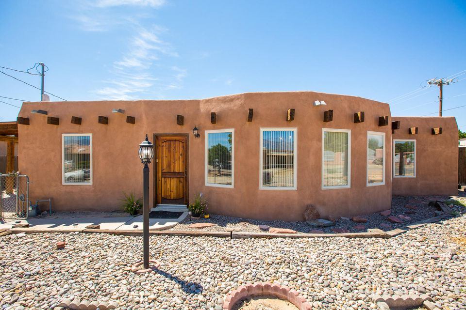 Beautiful Adobe home on half acre facing the picturesque Sandia mountains.  Three large bedrooms with office, two living spaces, separate dining room and kitchen with reverse osmosis system.  Brick flooring in many rooms. Water heater, heater and swamp cooler all new in August, 2018. New paint including stucco.  Space to build a garage but use the reinforced flooring in the storage shed for your vehicle until then. SO MANY POSSIBILITIES with this oversized corner lot in great location!