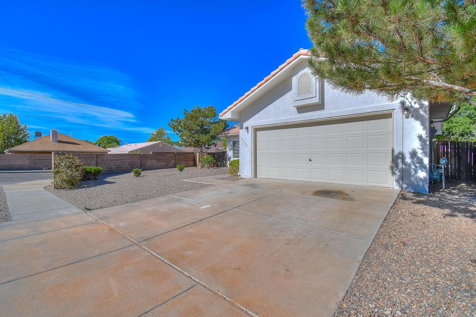 Light, bright, and clean home on a spacious corner lot in Albuquerque's sought after La Cueva school district, with possible side yard access! Inside you will be pleased to find new carpet, tile, and paint. Nice custom touches including a tray ceiling in kitchen and beautiful spanish tile roof. Newer hot water heater as well! Large backyard ready to do as you please. Come check out this lovely home, ready for its new owners!