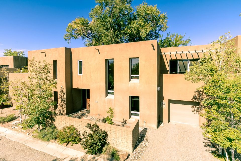 An incredible combination of bucolic setting and urban location between North Valley and Old Town! Designer Bill Osofsky and builder Bob Ruth combined forces to create this amazing residence in verdant, lovely and gated Acequia Escondida. Encompassing two floors on a wide lot, there are master suites on both the main and upper floors, guest bedroom with ensuite bath, two lofts and study. The great room concept has been taken to a new level with expansive living and dining areas opening to a gorgeous kitchen complete with stainless-steel appliances and iridescent glass tile backsplash. Outside finds courtyard, three patios, and raised garden beds. Two upper level decks with tree-top views. Three car garage. An idyllic enclave in a convenient location close to Downtown and the Bosque