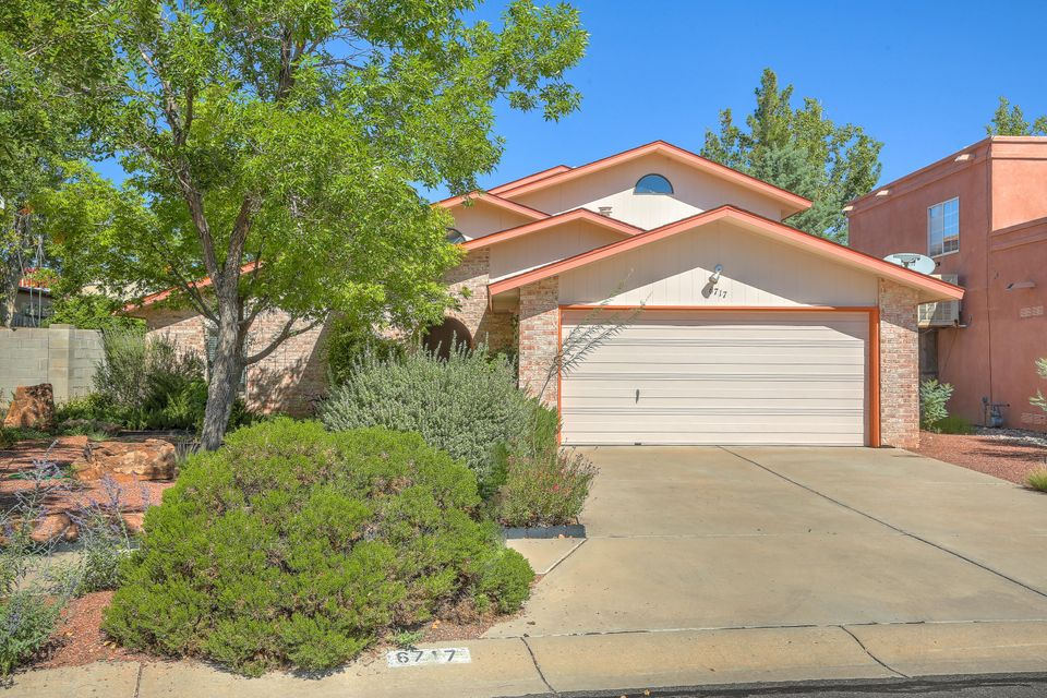Charming and unique home walking distance to the Petroglyphs. 4K in new Andersen windows. Well maintained with updated Kitchen and Baths. Wood and tiled floors through out.  Cathedral ceilings, clerestory windows and wood burning fireplace with  brick hearth are featured in the formal Living room.  Kitchen has granite counters and lots of cabinet space. Cozy Family room great for media/TV room.  Private upstairs Master Suite with luxurious bathroom, garden jetted tub, separate shower, vanity, water closet and custom tile. Master offers it's own balcony and bonus 16x10 study/nursery/hobby space. 2 car finished Garage with bonus attic storage space. Covered patio and deck in the back yard, nice for entertaining. Great location, close to trails, library, park and schools!