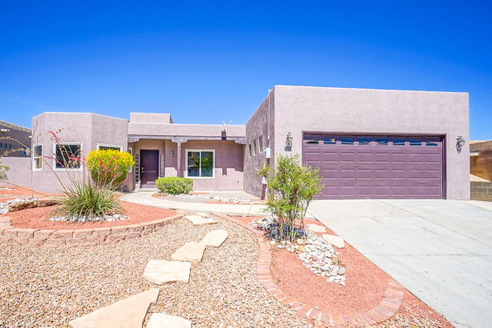 Remodeled Move-In Ready home in the Knolls of Paradise! This single story property has 3 bedrooms 2 baths plus an office/possible 4th bedroom! New tile flooring, new water heater, new lighting fixtures, fresh paint, stainless steel appliances and granite counter tops. High end refrigerated air system will keep you cool all summer. Backyard features an open patio with kiva fireplace, perfect for entertaining. Views of the Sandia Mountains throughout the property. Call a Realtor today to schedule a private showing.