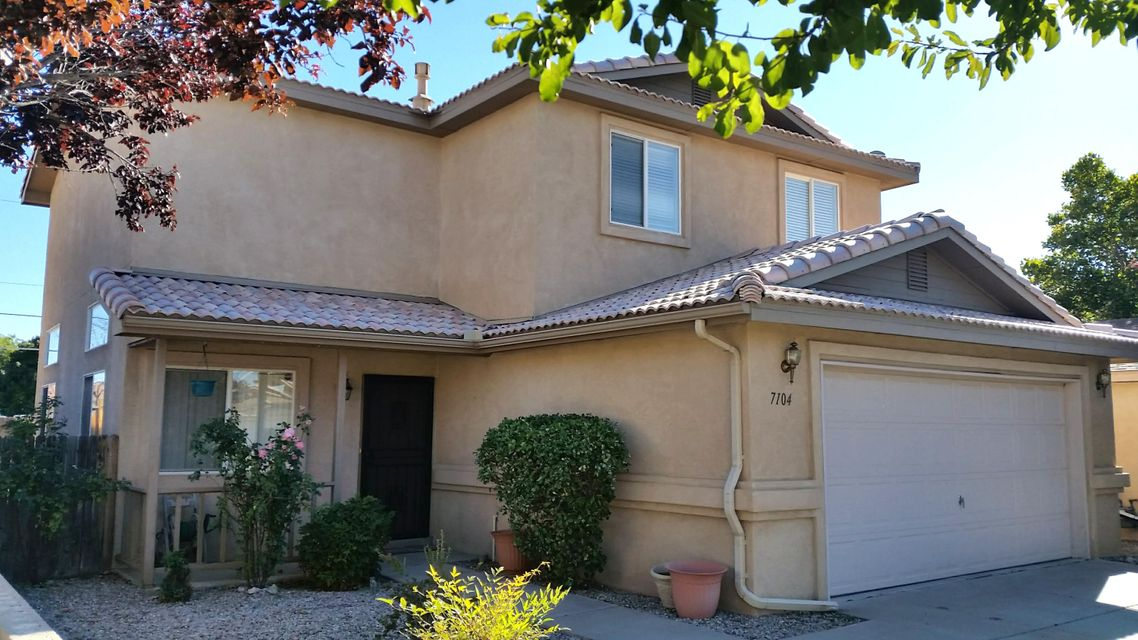 PRICE REDUCED! Open House Saturday, Dec 15, 11:00-3:00 pm. 4 bedrooms, the largest floorplan in the subdivision! Separate Master Suite on the lower level includes double vanity, shower/bath combo, double and triple size closets. Light, bright Kitchen & Dining Room with serving bar. Dramatic vaulted ceilings, impressive angled staircase. Three roomy bedrooms upstairs with their own full bath and shower/bath combo. Refrigerated A/C! Convenient lower-level 1/2 bath and laundry area. Back patio enjoys evening shade for BBQs & entertaining. Great location, North Star/Desert Ridge/La Cueva school district, 3 minutes from Paseo & I-25. Professional inspections completed, essential updates & cosmetic repairs have been done. You will enjoy living here!