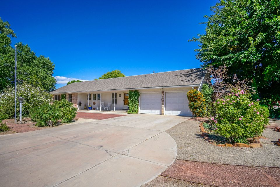 Open House Sunday 12-2! Grand single-story North Valley Estate on .52 verdant acres. Multiple living areas. 4 spacious bedrooms (possible 5). Living room boasts wood floors and cozy fireplace. Oversized recently remodeled kitchen with double oven, extra storage, granite, large island, gas stove. Entertain in the formal dining area or spacious outdoor patio. Master retreat with private office, full bath and private patio. The backyard is an oasis- irrigation well, koi pond, multiple decks, play area, storage area and garden beds. Circular front driveway, 2 car garage and backyard access for extra parking. Possible multi-generational living. Your retreat is here!