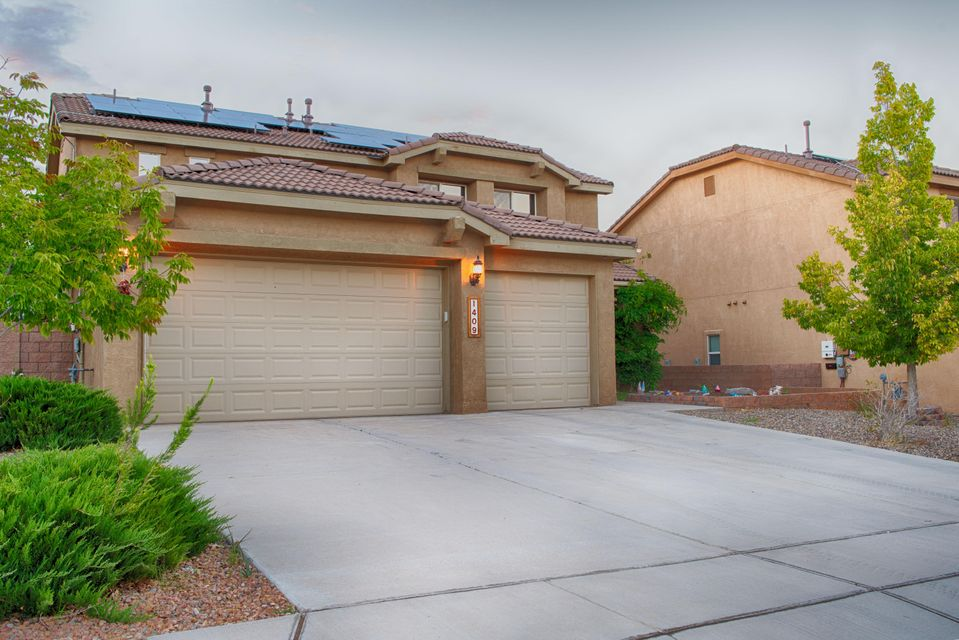A PLACE WITH SPACE! Enjoy a prized setting perfectly positioned for an effortless lifestyle. An airy, light-filled living room, kitchen and dining room in which to relax and entertain.  The well-designed outdoor space flows from the inside out.  Separate living spaces for kids and adults which offers sizable bedrooms. Master bedroom is located on the main floor.  Newer water heater, refrigerator & dishwasher.  Built in surround sound in the living room and back porch. This home is designed with energy-efficiency in mind with solar panels.Vivint security system (doorbell with camera, automatic locking doors and remote garage). Outdoor living is also pet friendly with a built in dog run.  Once you see this beautiful home, you'll want to own it!
