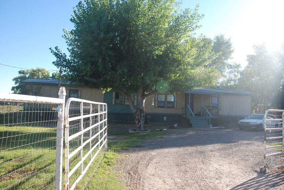 Great Little Mobile Home. Renovated in 2017. Now Occupied by Tenant who is Family Member of Owner. On One Acre of Irrigated Valley Land with Animal Pens.
