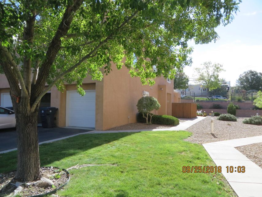 Nice ready to move in 2 Bedroom near services, CNM and park. Greatroom with fireplace and private patio area ; 2 bedrooms up stairs with some mountain views. Gated community with nice grounds . All appliances convey.