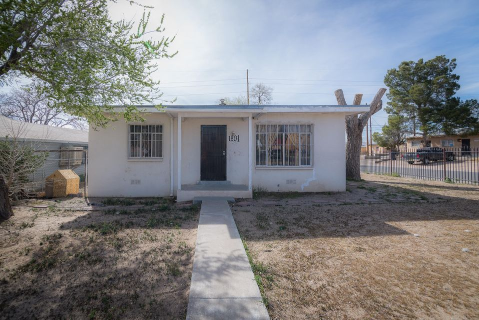 4 Bedroom home on a larger corner lot with backyard access. Fully fenced lot with carports. Open floor plan. with a good size master bedroom.
