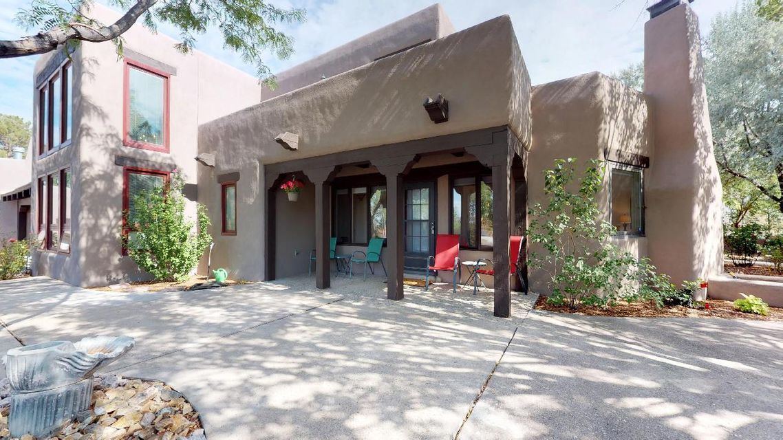 Magnificent gem, nestled on almost an acre of land is a must-see!  Expansive master suite, on main level, has its own private courtyard & fireplace.  All upstairs bedrooms have their own private bathrooms.  Kitchen updates include stainless steel appliances, quartz counter-tops, and lots of cabinets.  New septic has been installed, as well as new asphalt from street to over-sized three car garage; it's been updated to house larger vehicles!  Master bedroom has its own private courtyard for intimacy and a massive master bathroom!  Back yard is large enough to build a casita or pool and boasts a courtyard made-ready for entertaining.