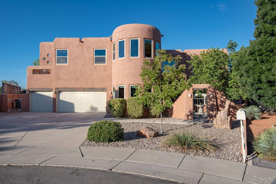 Exceptional North Valley home with a backyard made for entertaining! A gated courtyard creates a welcoming entry to this beautifully maintained home.  Double height entry way welcomes you to a formal living room and dining.  Granite countertops, brand new stainless appliances, island, bar and breakfast nook create a kitchen for everyone; opening to the family room with NM style adobe fireplace. French doors open to the backyard  to double your entertaining space! A full outdoor kitchen with grill, fridge, built in seating and kiva fireplace. Oversized master w/ fireplace, private deck, walk in closets and office/exercise area on the 2nd floor. Master bath includes double sinks, jetted tub, separate shower, & water closet. Optional 1st floor master. Pre-inspected and all repairs complete!