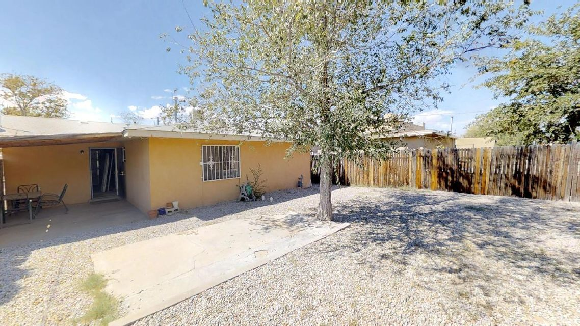 Affordable 3 Bedroom in the UNM area with a garage, also, has both front porch and  a covered patio. In addition, great for anyone needing LOTS of yard space, backyard has alley assess and a huge lot.  let's make a deal!!!