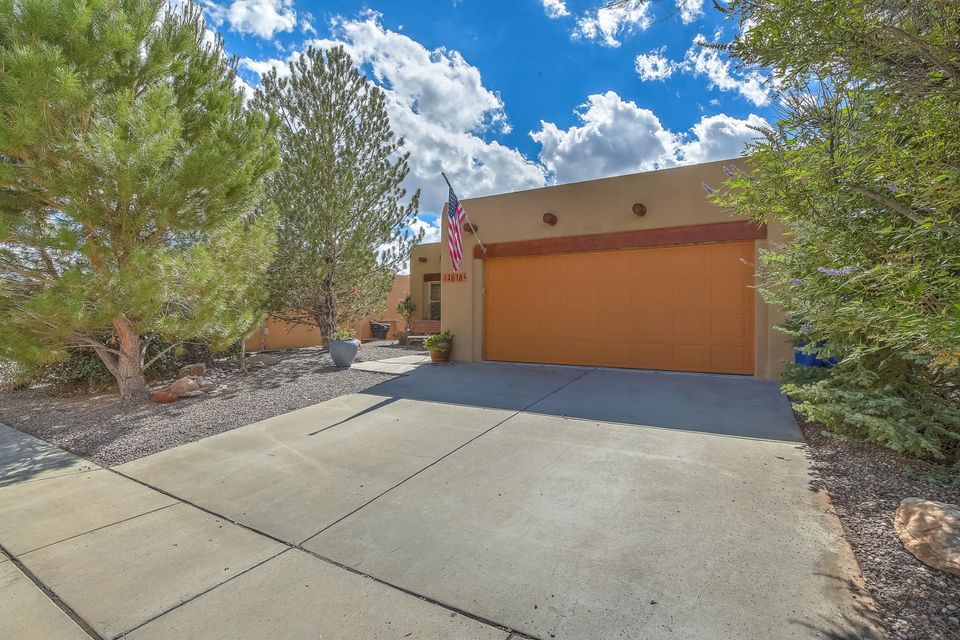 Custom home in fabulous 7 Bar North! Exceptional mountain and city views. Open concept living & kitchen, Granite counter tops and stainless appliances. Custom beamed ceilings. Great natural lighting. Cozy kiva fireplace for those chilly nights. Bonus study or office suite. Spacious master suite on main level with large bathroom, garden tub and separate walk-in shower. Generous closet space with built-ins. Open and bright floor plan with two bedrooms upstairs. Bonus den or extra family room downstairs. Rare to find a walk-out basement in ABQ. Exceptional custom details throughout. Nearby shopping, dining and entertainment. This home is truly move-in ready!!!