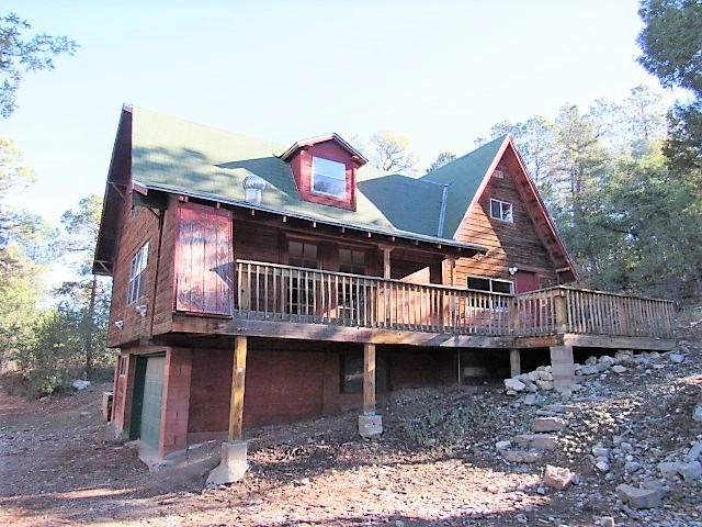 Mountain living awaits you! Cabin style property with plenty of space inside and out. Bring your vision and make this into your dream escape and retreat. Fresh mountain air!