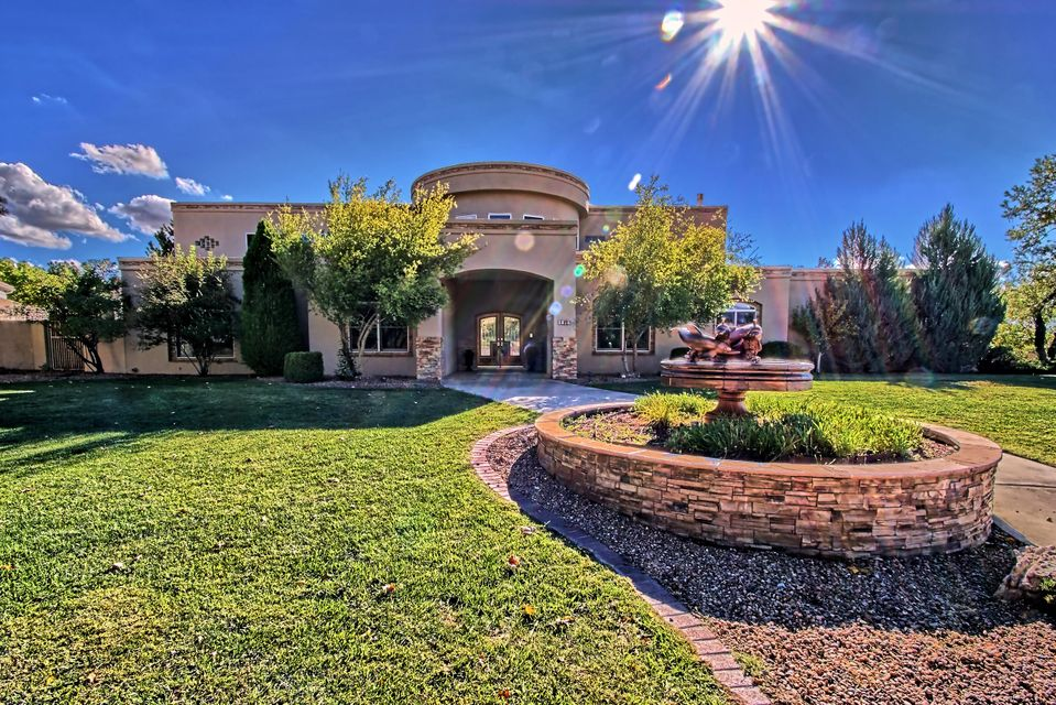 Wonderful Custom home nestled in A private Gated Community! Living room features two-story ceiling with hand carved tongue and groove beam ceilings! Beautiful Hand carved fireplace mantle with gas log FP! Custom wood staircase! Kitchen is truly the heart of the home with spacious wonderful open and flowing design! Abundant cabinetry and counter space! Huge granite slab island! Kitchen is open to the spacious GR, featuring gas log FP with travertine surrounds and custom wood mantle! Wonderful home theater room with custom wood cabinetry! Inviting true Home library, office,  with custom built-in bookshelves, wood flooring, glass double door entry! Absolutely fabulous outdoor living complete with recent huge pool to enjoy! Large shade trees, grass area!