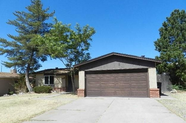 Nice NE location and a spacious floor plan with multiple living areas and a fireplace. Come and see the potential to make this your dream home!