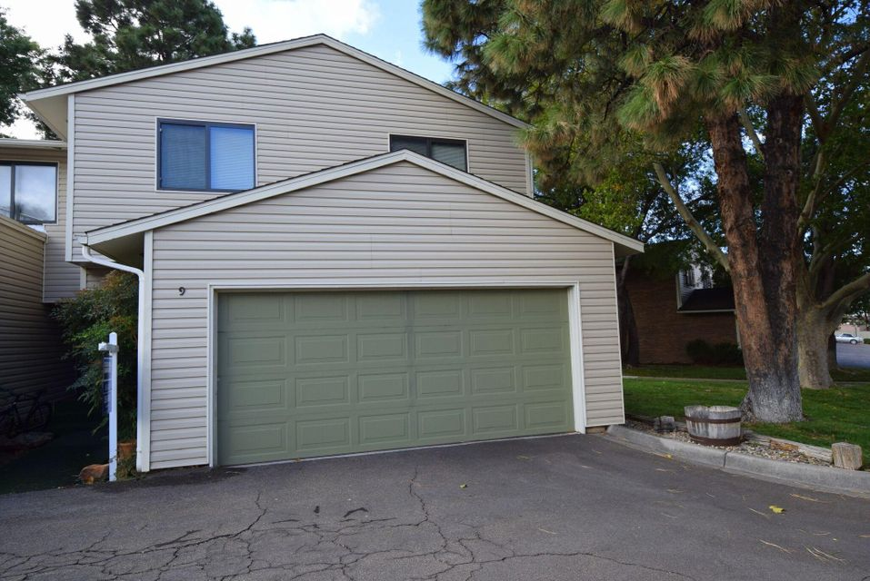 This home is the largest floor plan within The Shores of Albuquerque.  With five offset levels this home has space for everyone.  Three large bedrooms, 2 1/2 baths, living room with fireplace, den with fireplace, kitchen, dining room and a basement game/hobby/mancave with bar.  Private yard which backs to one of the two ponds on the property.  The community also offers tennis court, pickle ball court, walking paths, clubhouse, workout room, and swimming pool.  HOA fee covers Water/Sewer/Trash, exterior maintenance (roofs and siding), exterior insurance, all common area maintenance and common area taxes.  You can't get these amenities for this price anywhere else in the NE.  Compare total loan costs including the HOA fee and you will see just how affordable it is to have it all.