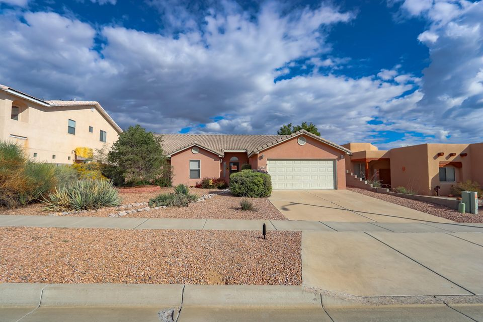 Don't miss this well maintained custom home with an open floorplan.  This alluring home has a very comfortable and spacious great room, resplendent natural lighting throughout,  walk in closets, refrigerated air, newer appliances, and easily maintained landscaping with full drip system garden.  Very close to Petroglyph National Park and Open Space.  This home IS move in ready.  Come and see it today!