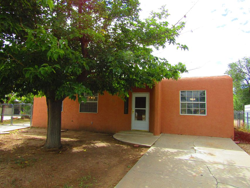 Charming three bedroom one bath in the Valle Vista neighborhood. Features include a reinforced RV pad, back yard access, workshop, updated stucco work, new carpet through out and the interior has been freshly painted. Some new windows have also been installed. Inside you will find three nice sized bedrooms, a full kitchen, and two living areas. During those cold winter nights you can warm yourself or curl up with a good book next to the ornate wood burning stove. And during those hot summer days the covered patio offers a chance to relax or entertain. Nice centralized location minutes from Old Town and I-40.
