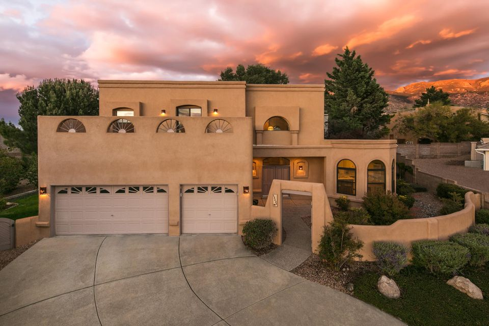 Located on a quiet cul-de-sac with stunning views of the Sandia Mountains and the City. Enter the home through the private front courtyard. Upon entry you are greeted by the spacious Living Room with a commanding firepalce and a raised ceiling. The Kitchen is a chef's dream! Offering lots of counter space for prepping and ample cabinet space for storage. The Master Bedroom is on the main level and offers a large walk-in closet and a full bath. Upstairs you will find a loft with a balcony, as well as 2 spacious bedrooms and another balcony with stunning City Views, The private backyard offers a covered patio, as well as open patio space, and lush grass. New stucco, roof, and windows. Great location, close to The Open Space Preserve, & easy access to Tramwway, Shopping, & Schools.