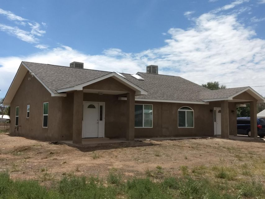 4 beds 2 baths 1,992 sqftNewer duplex in Pueblitos on 1 acre, just south of Belen. Custom built in 1999, this 2000 sq ft duplex has many possibilities. Each unit has electric and natural gas and is separately metered. Unit 6a is two bedrooms, one full bath, great room, full kitchen and a laundry. Unit 6b is the same but is larger and also includes a garage. Both the units are connected by a double door access, if both units choose to open their side (like adjoining hotel rooms). ADA accessibility. New stucco, New low-E glass windows, New kitchen and bath cabinets, New carpet, New light fixtures and New paint. A New roof with 30yr dimensional shingles.