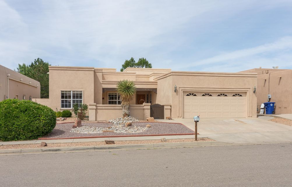 BEAUTIFUL single level custom home, loaded with Southwest CHARM, located in a high demand far northeast heights subdivision, Vineyard Estates! Just minutes to top rated schools: Desert Ridge Middle & La Cueva High School! Delightful courtyard entry;step inside & fall in love! Discover exposed adobe walls, tongue & groove raised beam ceilings, UPDATED bathrooms; NEW carpet & NEW STUCCO 2018! Awesome great room with Kiva gas log fireplace & wall of windows! Deluxe kitchen offers granite, stainless steel appliances, skylight, pantry & abundance of custom cabinetry. Formal dining room! French doors open to the generous portal & lovely private backyard with extended patio & vegetable garden! Large master with backyard access & master bathroom w/jetted tub, vanity with granite, separate shower.