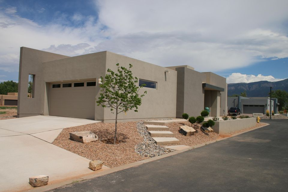 Newly Completed! Gorgeously upgraded, Contemporary style, an Abiquiu floor plan in the quiet, beautiful, gated subdivision of Bosque del Rio Grande. Access to the Bosque, and partial Bosque and Sandia Mountain views! 3 Bed, 1.75 Bath open floor plan features the following upgrades: sliding barn door to 3rd BR/Study, contemporary gas log FP, SS appliances (micro-hood, gas range, dishwasher), tile everywhere except carpeted bedrooms, granite counter tops, deco tile backsplashes, landscaped front. Backyard w/stucco wall (not landscaped). Separate Owners' Suite w/huge WI closet, double vanity, WI shower. Taexx Integrated Pest Control, auto front bubbler, grinder pump. See Standard Features for minimum Standards and long list of energy saving Green Features included in all homes in subdivision.