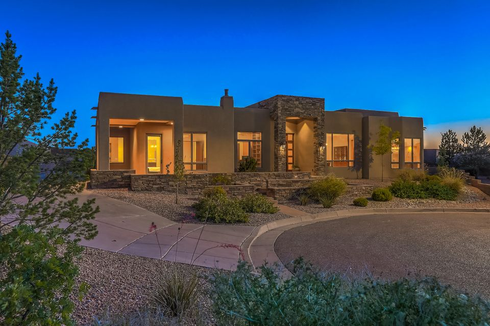 Spectacular opportunity awaits for the lucky buyer of this single level luxurious High Desert home backing to open space on a super private lot. 3 bedrooms plus study with closet could easily be 4th bedroom there is also a builtin desk with granite counters in the hallway.Spacious owner's suite with private patio, gas fireplace, sumptuous bath with his/hers vanity, jetted garden tub, double shower and grand walk-in closet. Tremendous mountain views and western views to Mt Taylor. Radiant heat plus heat/cool combo units, slate flooring, theater room, huge family room, gourmet kitchen is very well appointed with wolf range, asko d/w, subZ ref, 2 sinks, wine ref. butlers pantry. This exquisite homes exudes quality. Ultimate lifestyle with walking, hiking and biking trails just steps away.