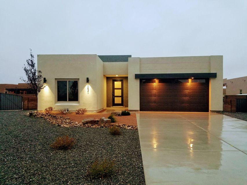 Under Contract Taking Backup Offers.  Brand new home in the beautiful Volcano Cliffs community! This home features 2,211 sq. ft. with 3 beds and 2.5 baths. The open floor plan with 12' ceilings above living/dining/kitchen and 10' ceilings above master bedroom/bathroom feels spacious and luxurious. Living area contains a custom gas fireplace and not one, but two large, three-panel doors that slide completely into the wall.  This maximizes your ability to live outdoors or entertain a crowd on the beautiful patio/courtyard with stunning views of the sunset! Granite in kitchen/baths/laundry, upgraded stainless steel appliances, custom cabinets, ceramic wood-look tile throughout, freestanding tub, TerraNeo accents, etc. Floor throughout is flat and accessible.