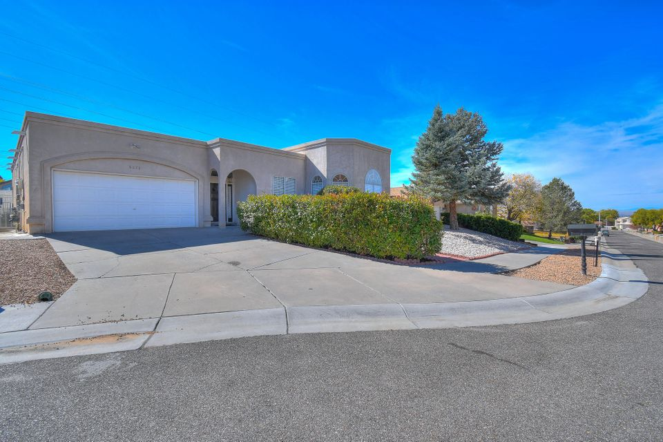 Welcome to one of Albuquerque's finest developments of Heritage East, located in the heart of the heights. The moment you cross the threshold for the first time you will understand why this is the perfect space for you and your family. Every corner of this spick-and-span home has been meticulously maintained as though it was a model home. This modern-open concept is light and bright, warm and alluring with massive 10' ceilings. With three separate living areas there is an abundance of space for entertainment and activities. Your new kitchen is large and highly functional with soft close hinges on all-wood cabinets, the 42'' upper cabinets are capped with a decorative showcase a triple stack cabinetry, under cabinet task lighting, level 5 granite, stainless steel appliances, and travertine