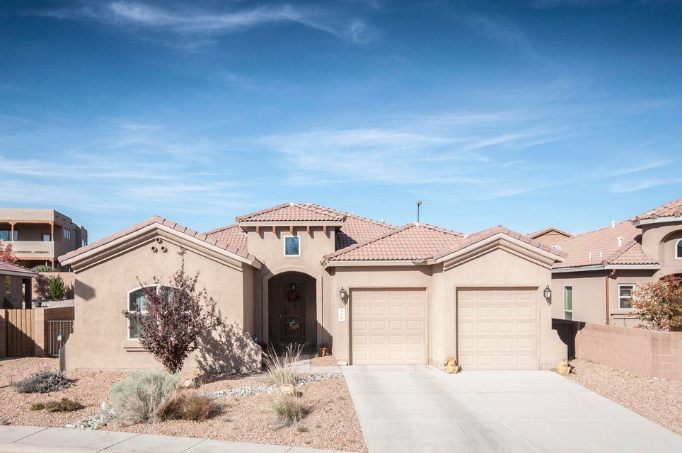 This beautiful home is the epitome of southwest desert living.  From the gated front entry way to the large sunroom, this home is perfect for entertaining year round.  The rustic country kitchen has gorgeous cabinets, a large island and a 5 burner gas range.  The semi-private office with built in desk and cabinets is located between the kitchen and the dining room. The large owners suite is separated from the other bedrooms for privacy. Located on the Rio Rancho / Bernalillo border this beautiful green home is in pristine condition. Just minutes away from local shops & quick access to I-25, yet sits inside a private family friendly gated community.