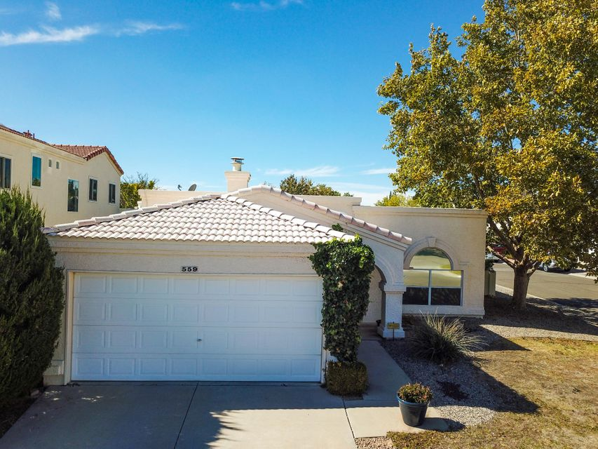 Come check out this Rio Rancho charmer! This exceptionally maintained 3 BDR/2 BA features custom accent paint throughout and a kiva style fireplace in living room.  Situated on large, landscaped corner lot in a established neighborhood. Backyard has mature trees and a covered patio that makes it great for entertainment! Conveniently located near shopping and schools. This beauty is move-in ready!