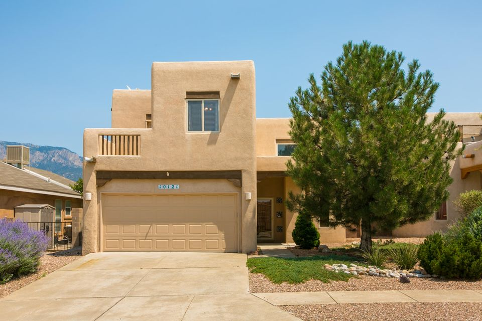 Now Offering Owner Financing! This Quintessence home has it all! Situated in the heart of North East Albuquerque, this amazing home offers three bedrooms, three bathrooms a two car garage and an office! Two balconies offer both city and mountain views! The roof was replaced with a rubber membrane roof and the home is equipped with refrigerated air. The side yard access leads to a well maintained backyard. 10121 Irbid Rd has close proximity to Quintessence Park, walking trails and your favorite NE Height activities