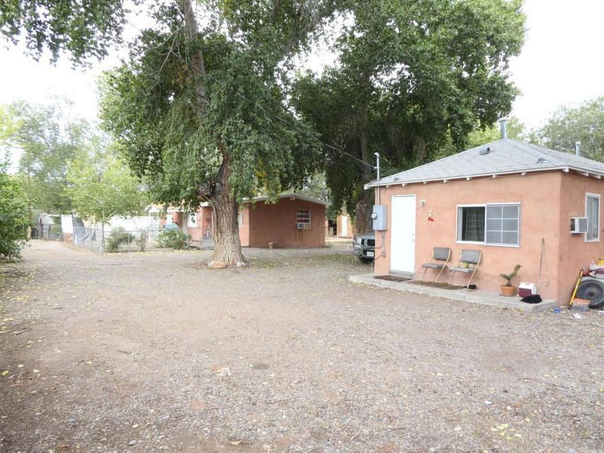 Great Investment Opportunity to own three units. There is a main house (Unit A) has three bedrooms and one bathroom. Unit B and C both have one bedroom and 1 bath. Right across from SW CNM campus. All units are currently occupied. **Please DO NOT disturb tenants***