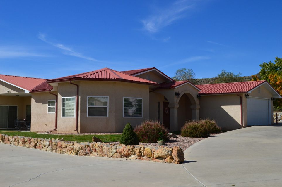 Located just a short walk to the Petroglyphs, this lovely custom home has a large greatroom with gaslog fireplace. Big country kitchen with island, pantry and large dining area. Three spacious bedrooms including master bedroom with walkin closet and bath with two sinks, jetted-tub and separate shower. Home has den/study/home office or formal dining room. Fully landscaped .33 acre lot with gated backyard access, RV pad with RV cover and storage shed. Circle drive in front.