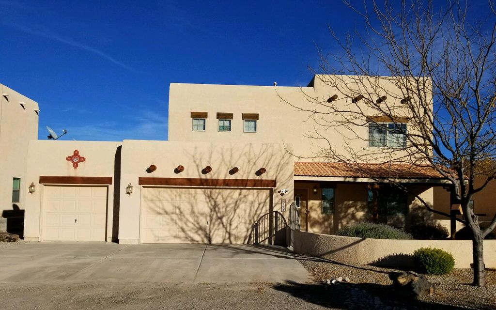Beautiful 4 bedroom 3.5 bathroom  home with 3 car garage and stunning back yard Views of the Sandia's Mountains and  Albuquerque.This  spacious 4 bedroom home has two master bedrooms, one down stairs and one   upstairs. It features a  back yard patio with beautiful viga post.