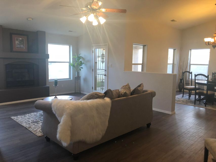 gorgeous updated home in Taylor Ranch. 3 bed 2 full bath, with RV parking.  You will enjoy the high ceilings, new flooring and new paint. come see this beauty and make it yours today!!