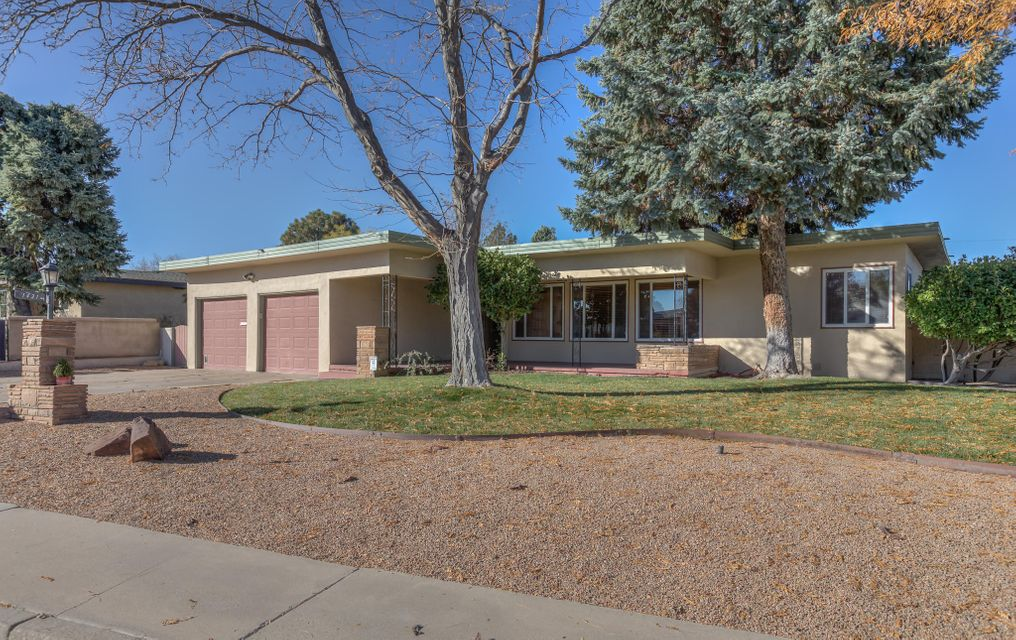 Beautiful home in close proximity to UNM campus and golf course.  The home is in immaculate condition with lush landscaping in front and back.  The lot is approximately 1/4 of an acre!