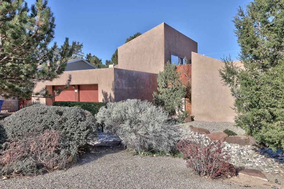 This unique southwestern style home sits in one of Albuquerque's most desirable neighborhoods.   Beautiful brick floors and tongue-in-groove ceilings give this home its special charm. Spacious 678sf master suite is an oasis with its own living area and  gorgeous mountain views. Delightful covered patio for outdoor entertaining along with  enclosed indoor pool.  Large eat-in kitchen. Oversized garage with two storage areas. One  could serve as small office.
