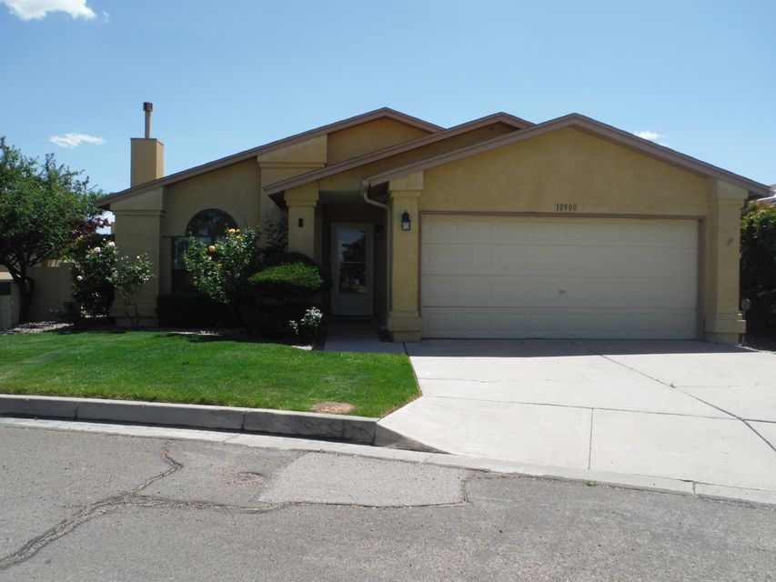 Great Location with views of the mountains and across from a green park & community pool.  This 1269 sq ft home has 2 bdrms, 2 baths, beautiful patio/sunroom & oversize garage.  Upgrades over the past 3 years include Refrigerated Air, Furnace, electrical box, kitchen sink & faucet, ceiling fans, solar tubes in the house and 2 in the garage. Newer Refrigerator, Range, Washer & Dryer all stay. Sun-room has east and south exposure and is perfect for growing plans and relaxing.  HOA is $115 per month and includes front yard maintenance, 2 parks, 2 pools, lily pond, tennis courts, workout room, clubhouse, privacy gates & more, Land is leased for $123 per month but can be purchase for $27,000 from HOA.  Close to KAFB, Sandia Labs, stores, restaurants, drug stores and general services.