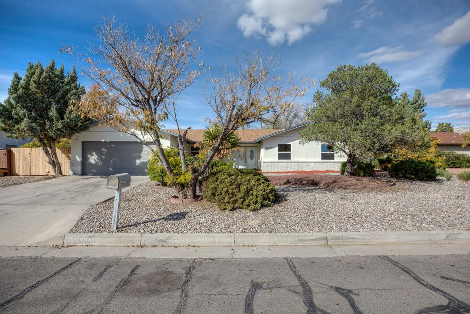 Come fall in love with this Panorama Heights home! Complete with contemporary finishes, this 3 bedroom home boasts stainless appliances, granite countertops, and master suite with walk-in shower. Located in the heart of Rio Rancho- only minutes away from schools, parks, great shopping, and dining. Call for your private showing and make this house your home today!